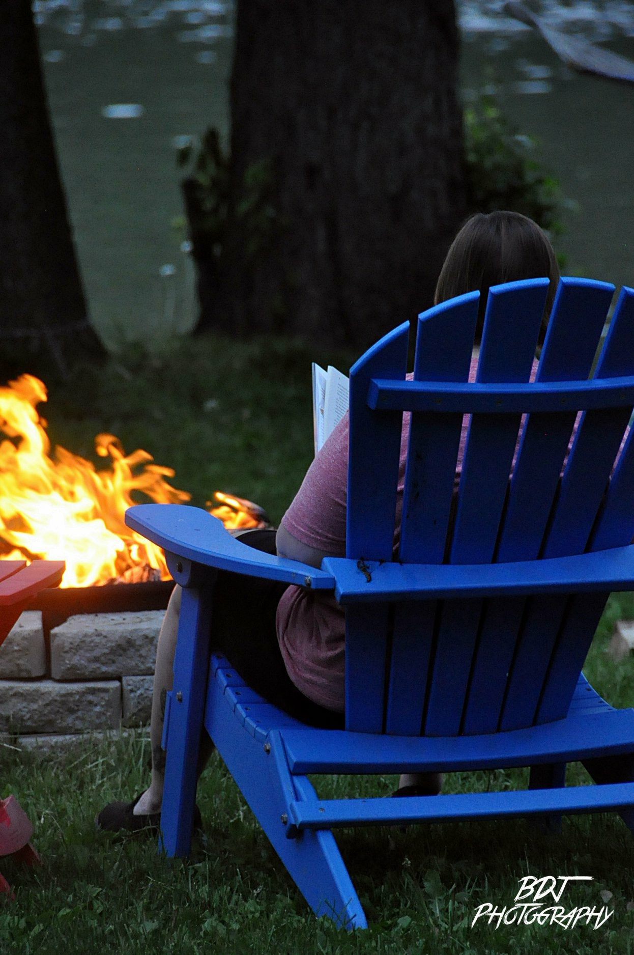 Reading by the Campfire in Cayuga County (photo)